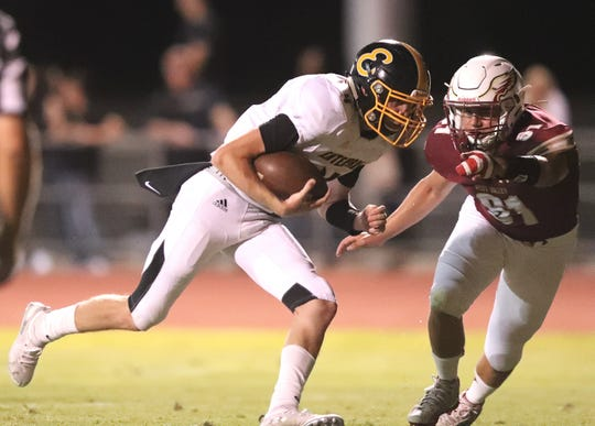 Enterprise quarterback Pierce Embury, left, runs for a touchdown in the Hornets' 42-28 loss to West Valley on Friday, Sept. 6, 2019.