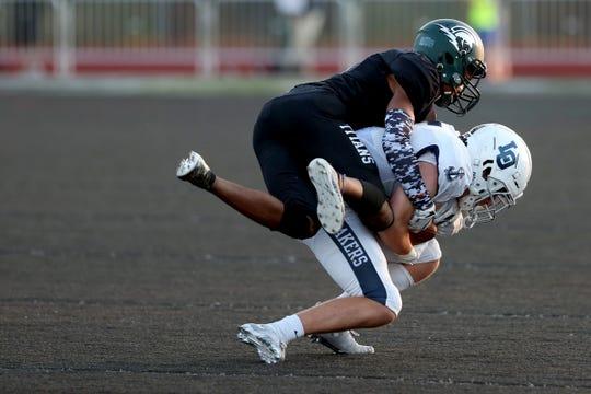 West Salem's Zariya Powell (8) tackles a Lake Oswego player in the Lake Oswego vs. West Salem football game at West Salem High School on Sep. 6, 2019. Lake Oswego won the game 42-21.