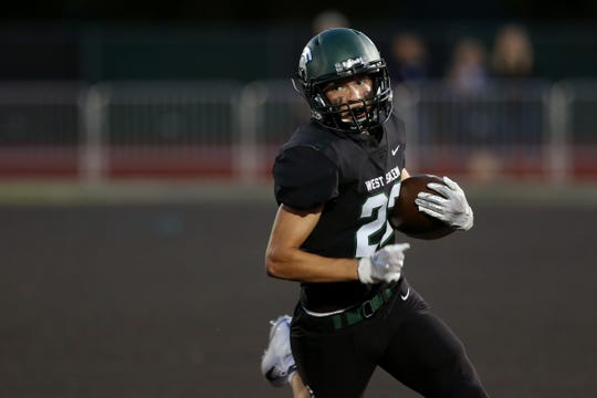 West Salem's Nathan Garcia (5) rushes in the Lake Oswego vs. West Salem football game at West Salem High School on Sep. 6, 2019. Lake Oswego won the game 42-21.