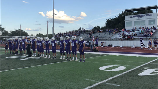 The Irion County Hornets line up for the coin toss before a six-man football game Sept. 6, 2019, at O.K. Wolfenbarger Field in Mertzon.
