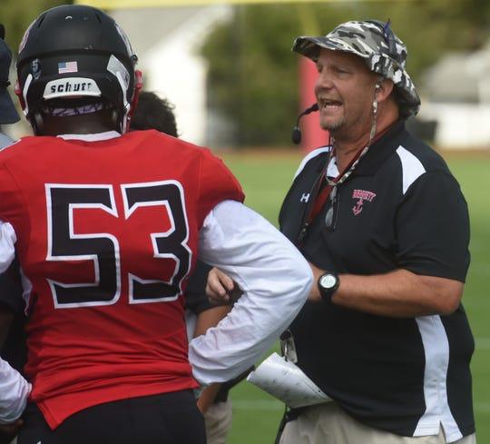 "James M. Bennett head coach Glenn ""Hoot"" Gibson talks with his team on Saturday, Sept. 7, 2019."