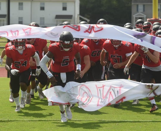 The James M. Bennett football team runs onto the field prior to a game against Easton on Saturday, Sept. 7, 2019.