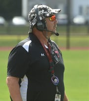 "James M. Bennett head football coach Glenn ""Hoot"" Gibson watches a play against Easton on Saturday, Sept. 7, 2019."