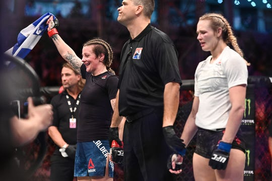 Joanne Calderwood (red gloves) reacts after defeating Shreveport's Andrea Lee during UFC 242 in Abu Dhabi on Saturday.