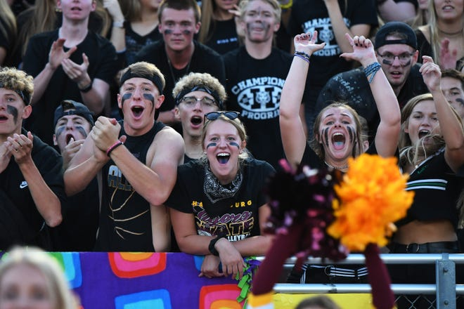 The Harrisburg High School student section cheers on the Tigers during the Class 11AAA matchup against Sioux Falls Washington on Friday night in Harrisburg.