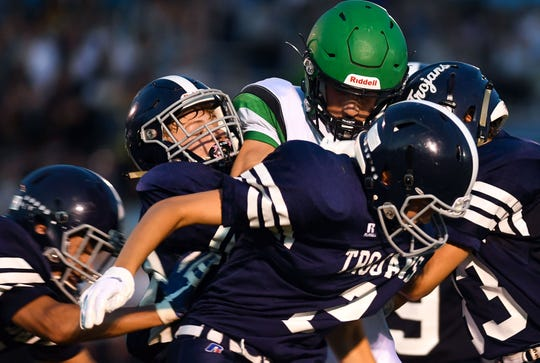 A Pierre player resists being tackled by four West Central defensemen during their game on Friday, September 6, in Hartford.