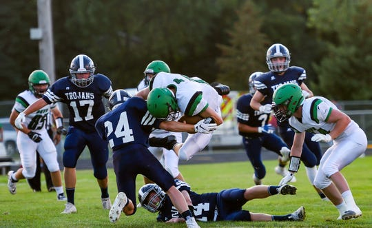 Garrett Stout of Pierre T.F. Riggs leaps over West Central players during their game on Friday, September 6, in Hartford.