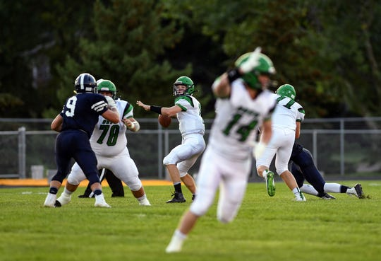 Garrett Stout, Pierre's quarterback, looks to make a pass during a game against the West Central Trojans on Friday, September 6, in Hartford.