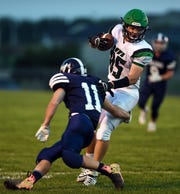 Collin Brueggeman of Pierre T.F. Riggs breaks free from an attempted tackle by Justin Zirpel of West Central during their game on Friday, September 6, in Hartford.