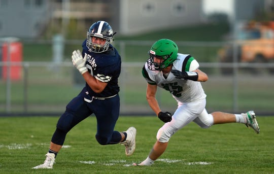 Regan Bollweg of Pierre T.F. Riggs chases after Cooper Maras of West Central during their game on Friday, September 6, in Hartford.