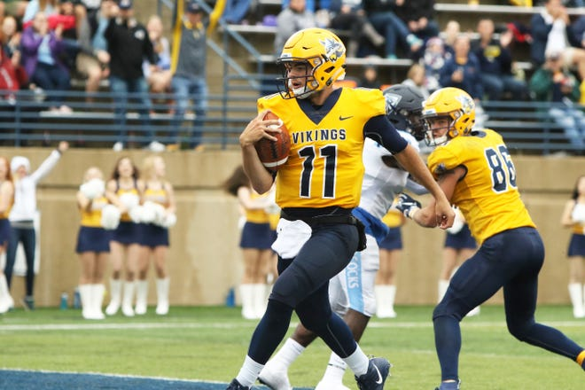 Augustana QB Kyle Saddler crosses the goal line for a second quarter touchdown during Saturday's game in Sioux Falls.
