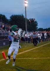 Andrew Coverdale, wide receiver for Pierre, catches a pass for a touchdown during a game against the West Central Trojans on Friday, September 6, in Hartford.