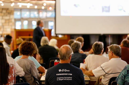 Community members listen to a presentation by consultant John Houseal with Houseal Lavigne Associates at a workshop put on by the city of Springfield to gather community input for a comprehensive plan for the next 20 years on Wednesday, Sept. 4, 2019.
