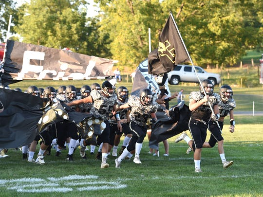 Buffalo Gap players take the field before Friday's football home opener .