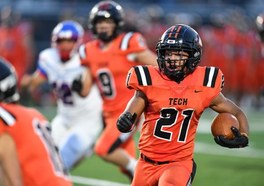 Tech's Kedrik Osuorah rushes with the ball during the Friday, Sept. 6, 2019, game at Tech High School in St. Cloud.