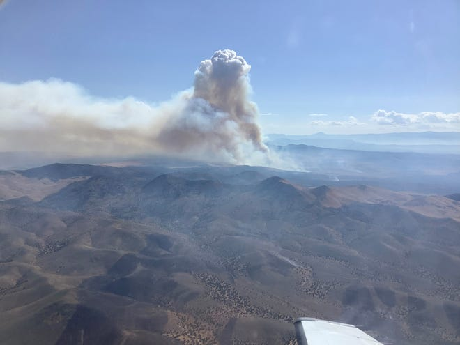 "An aerial photograph shows smoke billowing above the ""Neck Fire,"" a wildfire burning in Iron County on Friday, Sept. 8, 2019."