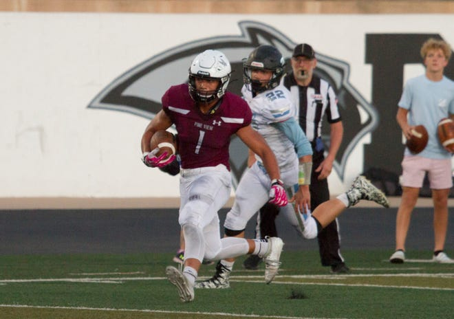 Enoch Takau (1) is one of the best players in Region 9 football this season.