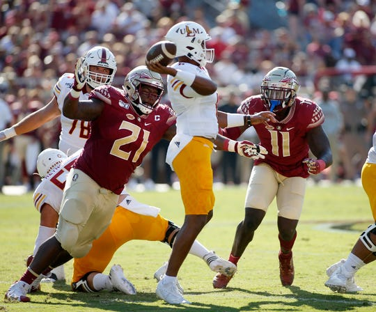 Sep 7, 2019; Tallahassee, FL, USA; Florida State Seminoles defensive tackle Marvin Wilson (21) and Florida State Seminoles defensive end Janarius Robinson (11) pressure Louisiana Monroe Warhawks quarterback Caleb Evans (6)at Doak Campbell Stadium. Florida State is hosting the Louisiana Monroe Warhawks. Mandatory Credit: Glenn Beil-USA TODAY Sports
