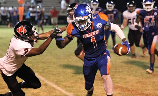 Jefferson County receiver Detrevian Nealy takes off on a catch-and-run while NFC's Daniel Sparks tries to make a tackle as NFC beat Jefferson County 42-36 in Monticello on Friday, Sept. 6, 2019.