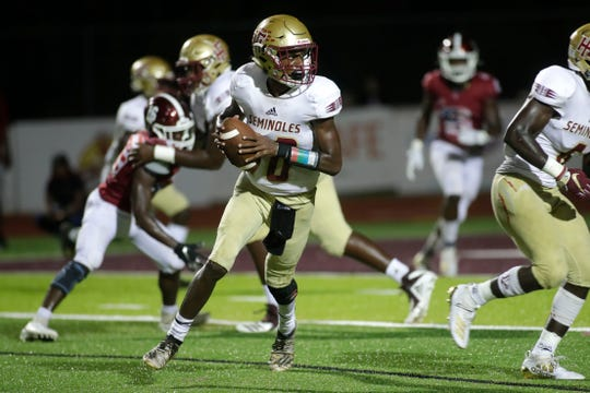 Florida High Seminoles quarterback Willie Taggart Jr. (10) takes a step back as he looks for a teammate to pass to. The Florida High Seminoles beat the Chiles Timberwolves 20-19 Friday, Sept. 6, 2019.