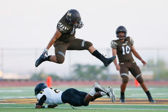 Austin's William Rodriguez III hurdles over Parkland defense during the game Friday, Sept. 6, at Austin High School in El Paso.