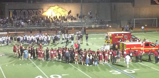 "Players from Oaks Christian and Sierra Canyon watch with concern as Oaks Christian player Mister Williams is put in an ambulance after suffering a neck injury Friday night. Williams took a helicopter to UCLA Medical Center, but he avoided serious injury and was diagnosed with a ""bruise"" to the neck area."
