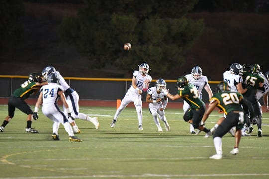 Camarillo High quarterback James McNamara fires a pass during the Scorpions' 56-0 victory over Royal on Friday night.