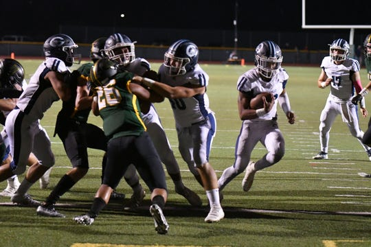 Camarillo High running back Jesse Valenzuela finds the opening to score one of his four touchdowns during the Scorpions' 56-0 victory over Royal on Friday night.