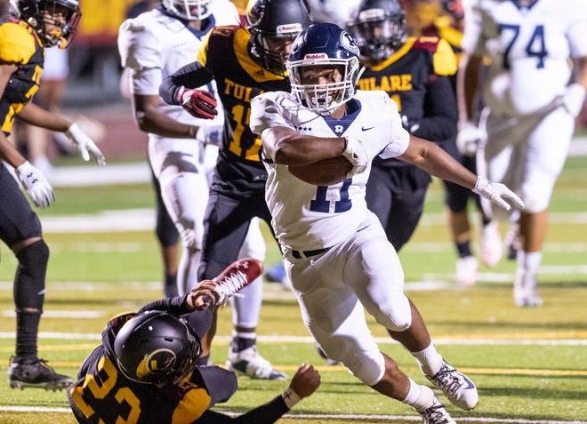 Redwood's James Richardson runs for a touchdown against Tulare Union in a non-league high school football game on Friday, September 6, 2019.