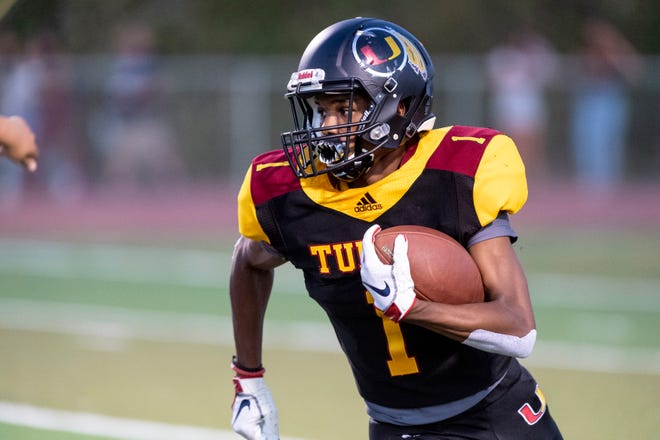 Tulare Union's Willie James returns a kick off against Redwood in a non-league high school football game on Friday, September 6, 2019.