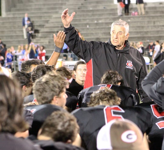Rye football head coach Dino Garr addresses his team after they defeated Eastchester 45-20 on Friday, September 6, 2019.