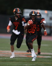 White Plains' Christian Young runs with the ball during a game against the Yonkers Force at White Plains High School on Friday, September 6, 2019.