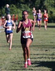 Arlington's Jaylyssa Smith wins the girls Division 1 race during the Big Red Cross Country Invitational at Somers High School Sept. 7, 2019.
