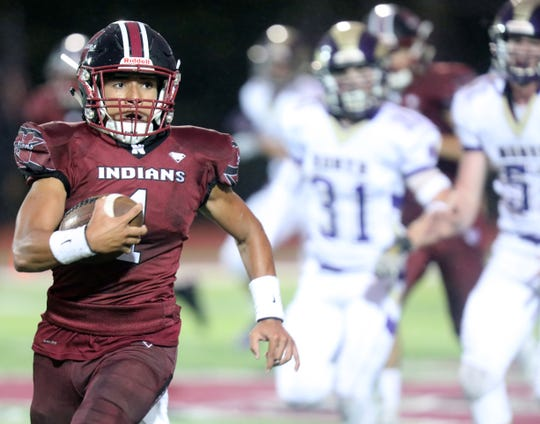 Nyack's Gavin Figueroa (1) pushes the ball up the field for a first down in the second quarter against Clarkstown North during Friday night football game at Nyack High School Sept. 6, 2019. Nyack defeated Clarkstown North 20-0.