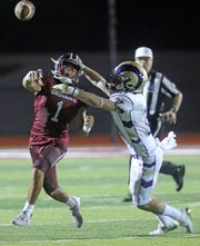 Nyack's Gavin Figueroa (1) passes the ball with Clarkstown North's Mike Farnan (11) guarding him during Friday night football game at Nyack High School Sept. 6, 2019. Nyack defeated Clarkstown North 20-0.