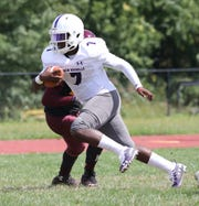 New Rochelle's Tariq Benjamin gains some yards during their football game against Mount Vernon, at Mount Vernon High School, Sept. 7, 2019.