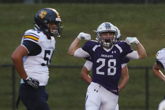 John Jay's John Connolly (28) celebrates his first half touchdown against Lourdes  during football action at John Jay High School in Cross River Sept. 6, 2019.  John Jay won the game 42-21.