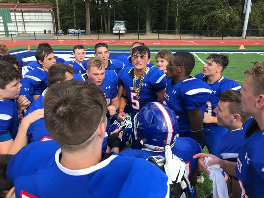 Pearl River's Anthony Sassano (5) leads a postgame chant after beating Westlake, 7-0, in the team's season opener. Sassone had a key punt and interception in the final minutes to seal the win. Sept. 7, 2019.