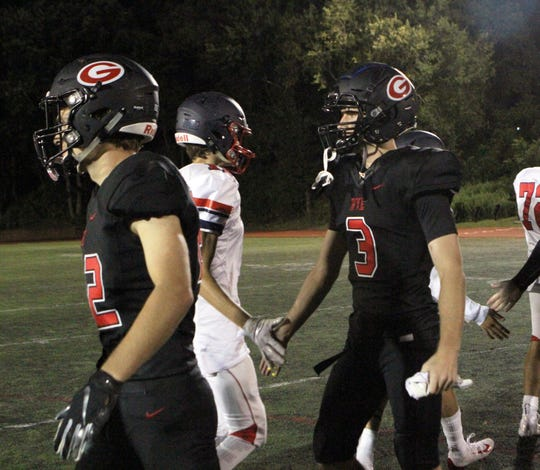 Rye's Quinn Kelly (3) in the handshake line after the team's 45-20 win over Eastchester on Friday, September 6, 2019.