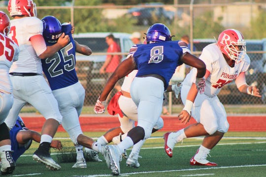 City View's Jourdain Durham (8) prepares to tackle a Ponder running back.