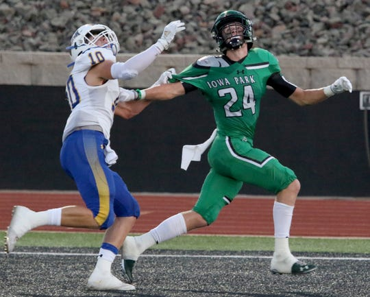 Iowa Park's Kaden Ashlock looks for the ball by Brock's Caleb Popeck Friday, Sept. 6, 2019, at Hawk Stadium in Iowa Park.