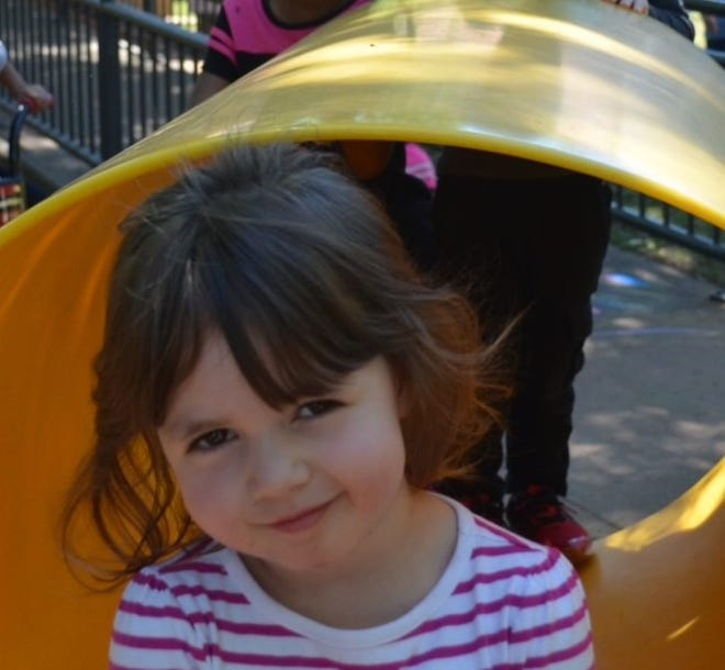 A little girl plays in a playground at a Child Care Partners center in this undated photo. The nonprofit is seeking to raise money to buy new playground equipment for all four of its centers with Playground Warriors, an event including an obstacle course, Thursday during Texoma Gives.
