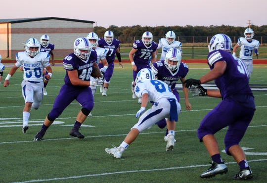 Jacksboro running back Caleb Helm (40) tries to get around Windthorst defensive back Gage Gillispie during a non-district matchup at Tiger Stadium in Jacksboro on Friday, Sept. 6.