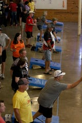 Teams compete in the Bags for Brags Cornhole Tournament Saturday, Sept. 7, 2019, in The Warehouse.