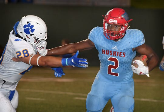 Hirschi Husky ball carrier Fred Fleeks (2) tries to get my Jake Gilbert of Frenship High School during second quarter action  Friday night at Memorial Stadium.