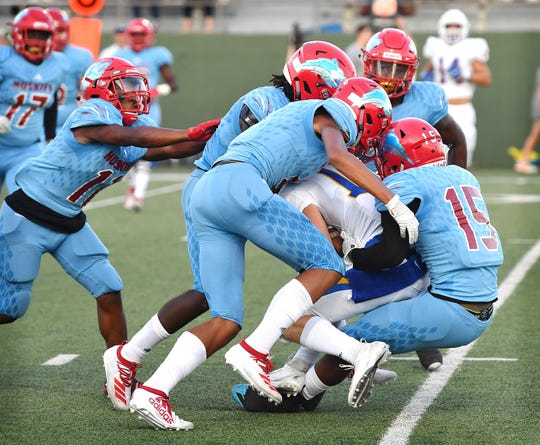 Frenship Tigers ball carrier Drew Hocutt (10) is smothered by  several members of the Hirschi defense  Friday night at Memorial Stadium.