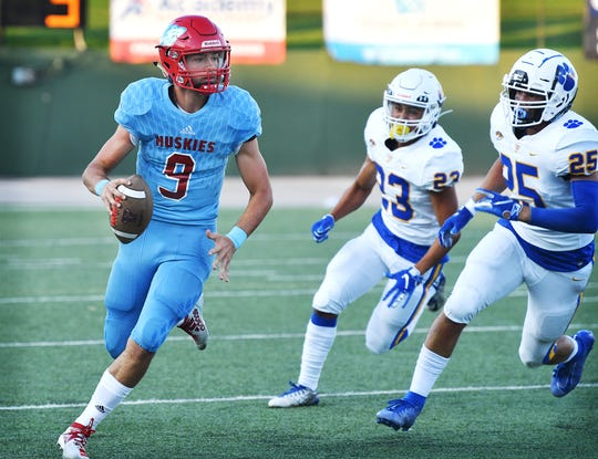 Hirschi quarterback Tryston Randall (9) looks for a receiver while avoiding Frenship Tigers Stefano Sanchez (23) and Logan Douglas (25) during first quarter action Friday night at Memorial Stadium.