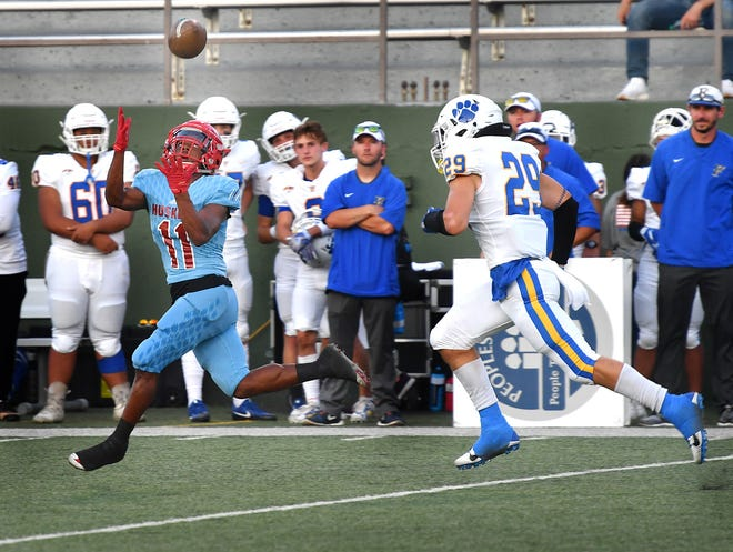 Hirschi receiver A'marion Peterson (11) hauls in a long pass behind Frenship safety Colton Anderson (29) for Hirschi's first touchdown  Friday night at Memorial Stadium.