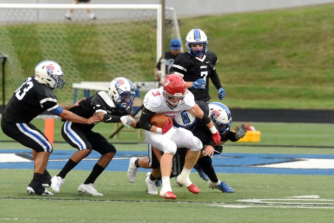 Zanesville players tackle junior Wes Myers during a game against Johnstown on Friday at John D. Sulsberger Memorial Stadium. The Blue Devils welcome Tri-Valley for the seventh installment of the series on Friday night.