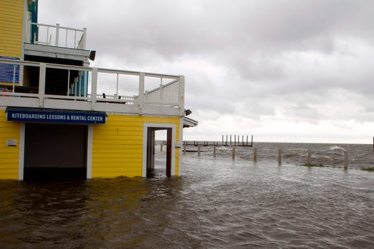 "A flooded shop is seen next to Rodanthe Sound as Hurricane Dorian hits Cape Hatteras in North Carolina on September 6, 2019. - The final death toll from Hurricane Dorian in the Bahamas could be ""staggering,"" a government minister has said as the storm lashed North Carolina in the US Friday with torrential rain and fierce wind."